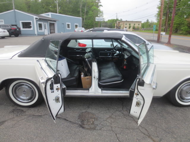 1966 lincoln continental convertible with suicide doors. Black Bedroom Furniture Sets. Home Design Ideas