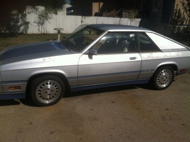 1984 dodge charger shelby hatchback 2 door 2 2l silver and blue all original for sale in mandan. Black Bedroom Furniture Sets. Home Design Ideas