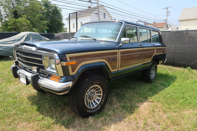 1988 jeep grand wagoneer woody 5 9l v8 4inch lift 31in tires updated radio for sale photos technical specifications description classiccardb com